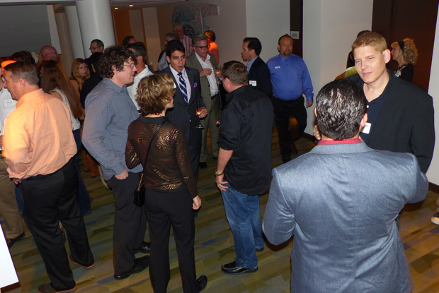 Above: The first of approximately 80 attendees to arrive for the South  Florida Domain Pros meeting get the networking party started.